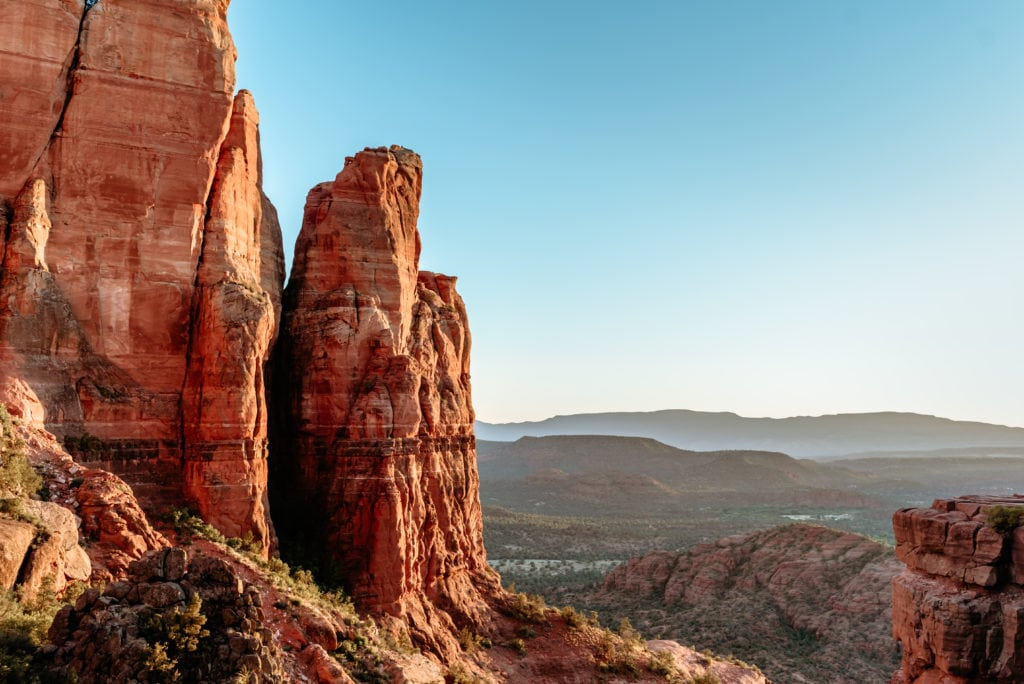 Sunset glow off the red rock spires at the summit of Cathedral Rock trail in Sedona, AZ