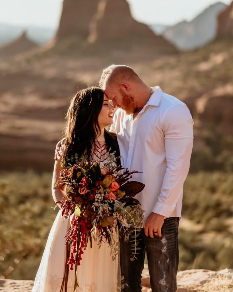 Elopement couple with giant wildflower bouquet in Sedona, Arizona