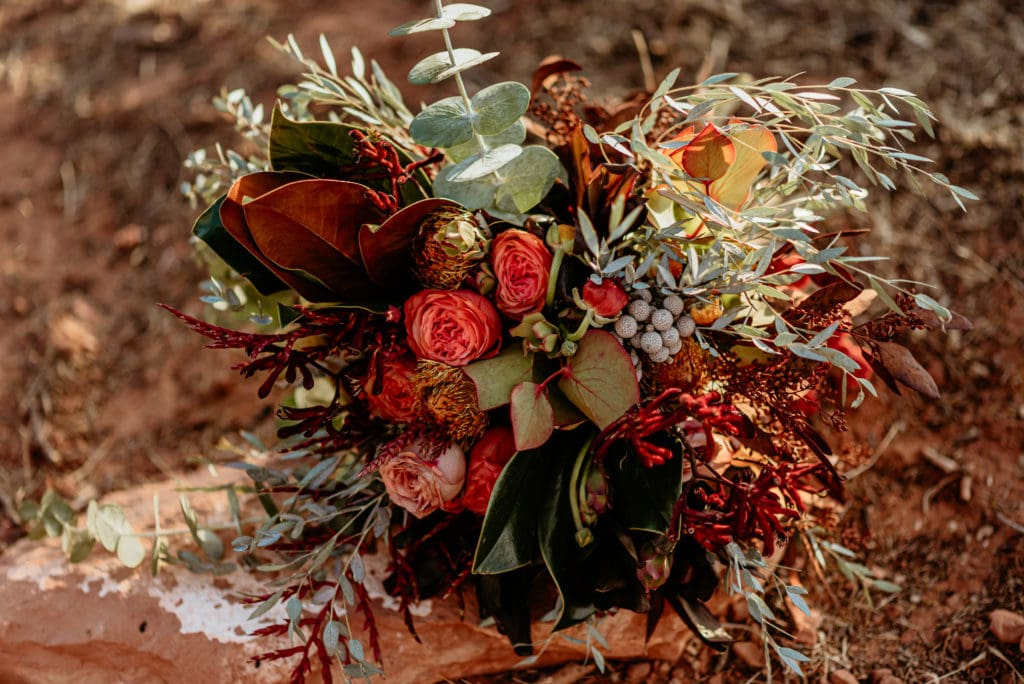 Gorgeous Red, Orange, and vibrant earth toned bouquet by Wildflower Design Co