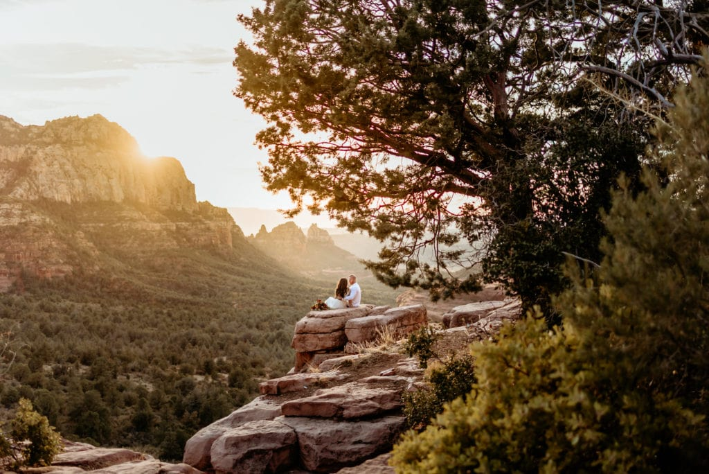 Elopement couple enjoying the sunset at Merry Go Round Rock
