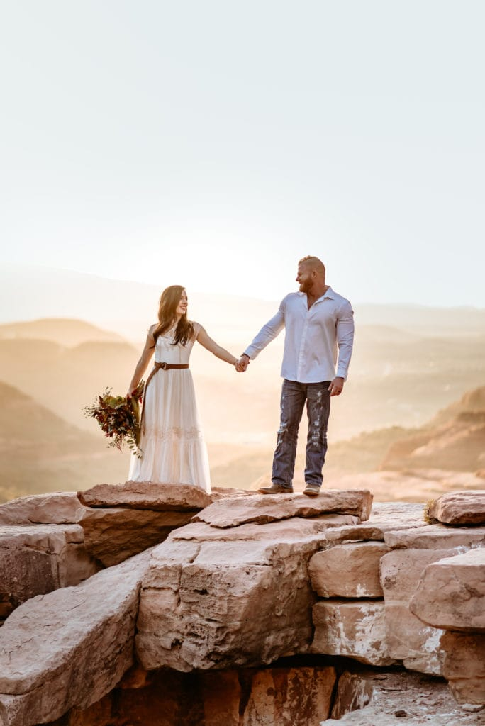 Bride and groom look at each other while holding hands during their Sedona elopement