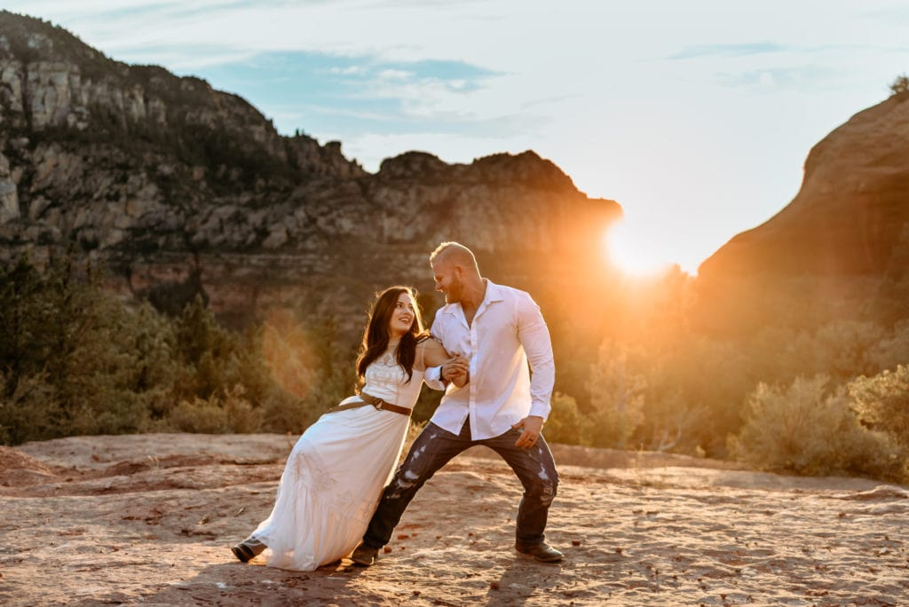 Gorgeous Sedona sunset behind dancing wedding couple