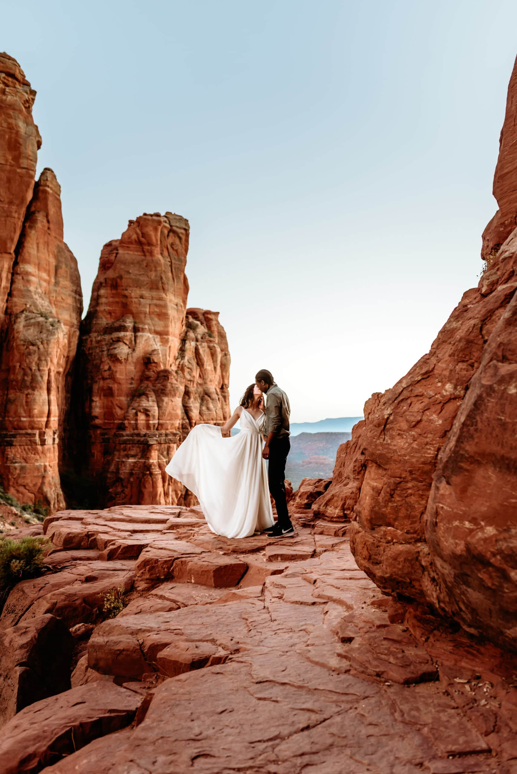 A dramatic kiss at the peak of Cathedral Rock by sweet elopement couple