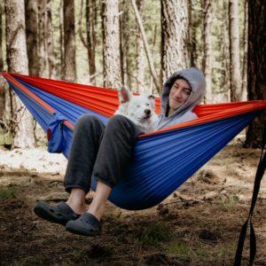 Evan Durazo in hammock with Aussie rescue