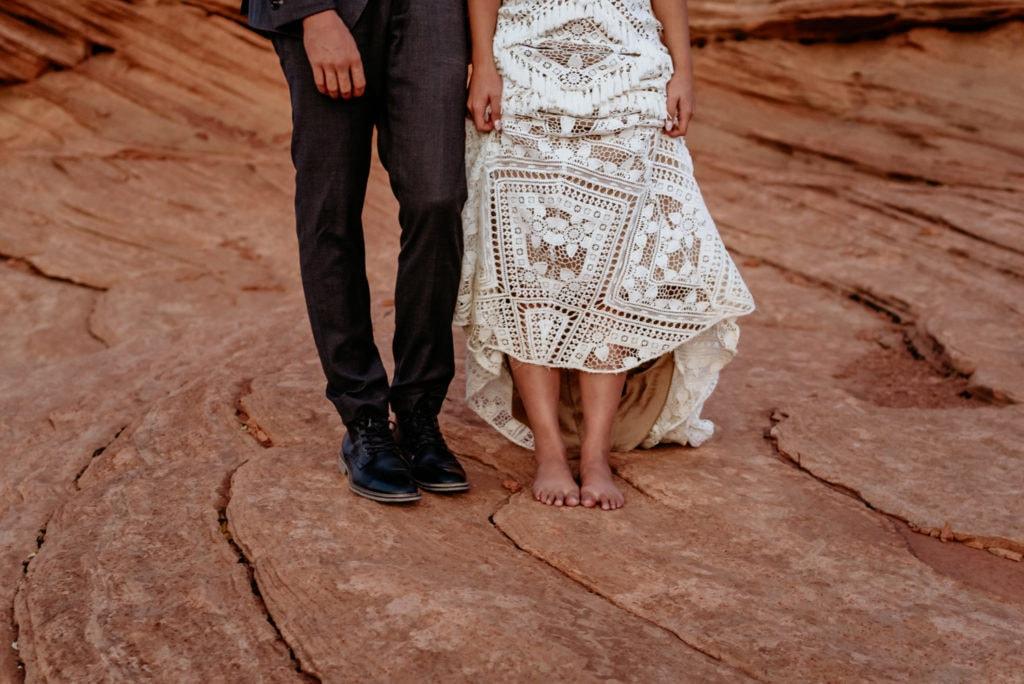 Bare feet under bride's lace Bohemian Rue De Seine elopement dress