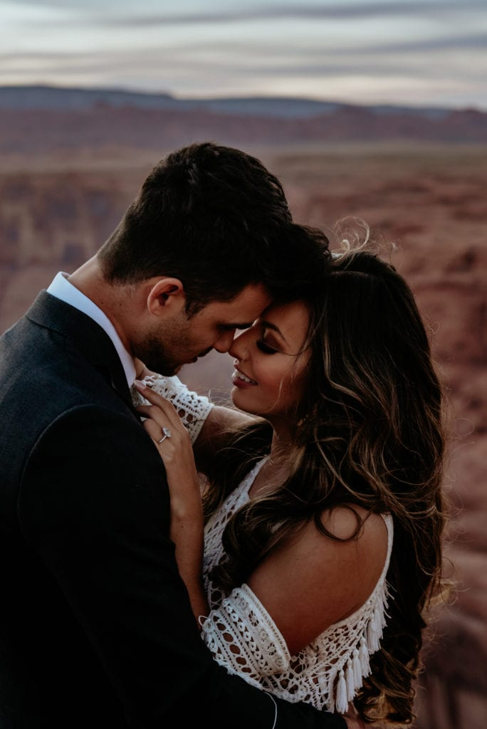 Bride and groom nuzzle during their Horseshoe Bend elopement