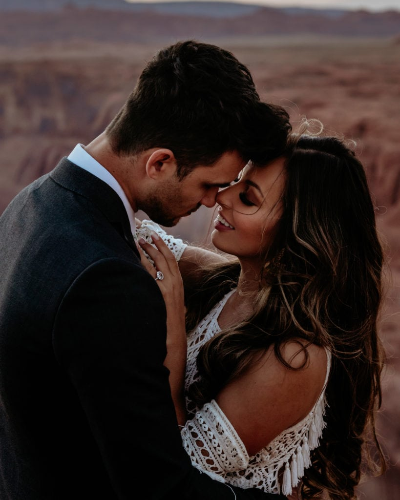 Bride smiles at groom during desert elopement