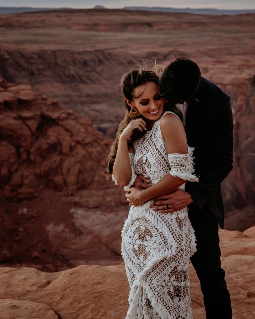 Couple smiles during their boho Page, Arizona elopement