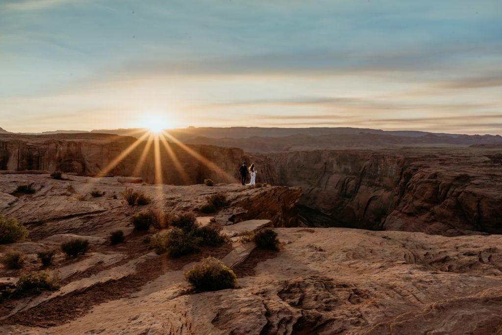 Wedding couple overlooking Horseshoe Bend at sunset