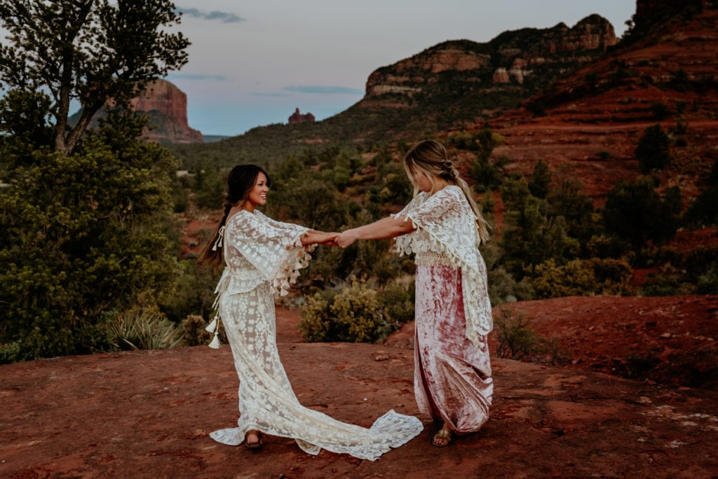 Best friends dancing and laughing during epic Sedona Sunset