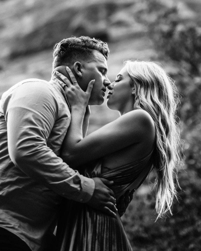 Intimate black and white image of a kiss