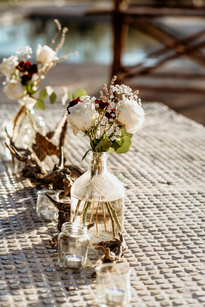 DIY floral arrangements on the buffet table during this Wranglers Roost intimate wedding ceremony