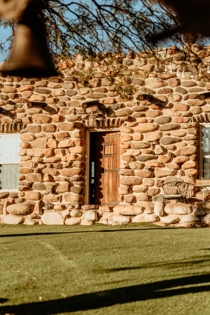 Southwest style door surrounded by river rock walls to the main house at Wranglers Roost in New River, Arizona