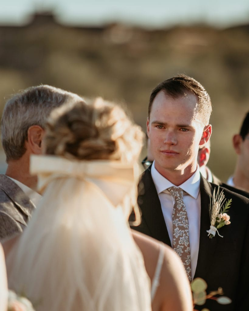 Groom looking lovingly at his bride to be during their Phoenix elopement ceremony