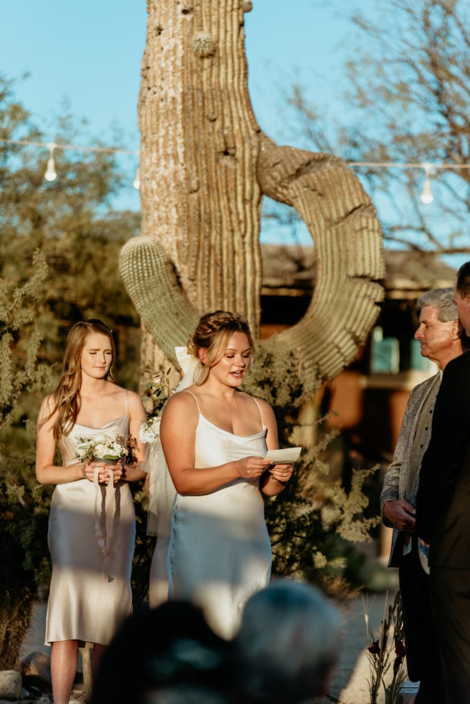 Bride reading her vows in front of a giant saguaro cactus at Wrangler Roost outside Phoenix, Arizona