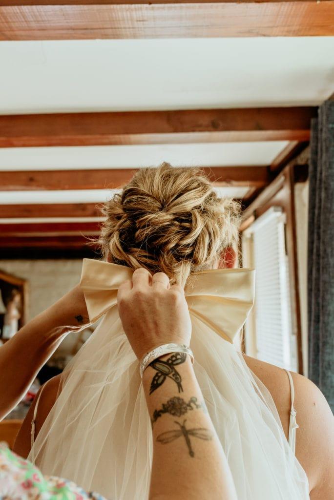 Mom pinning bride's late grandmother's veil