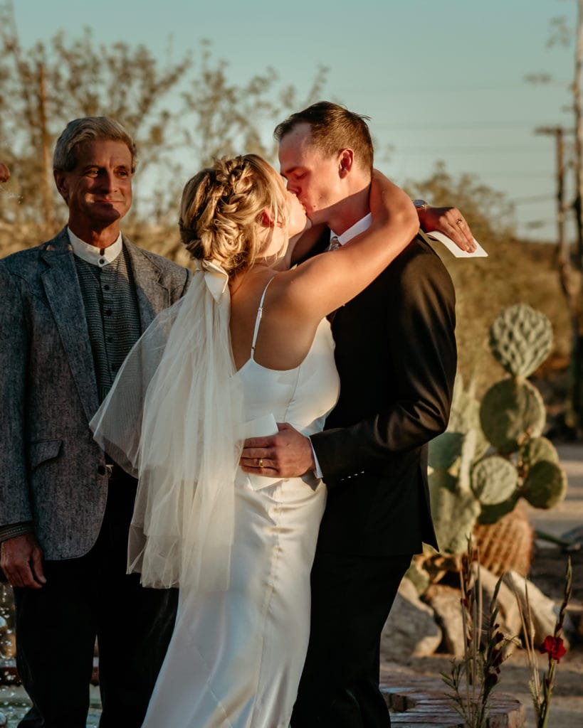 Couple's first kiss as man and wife during their Phoenix wedding ceremony