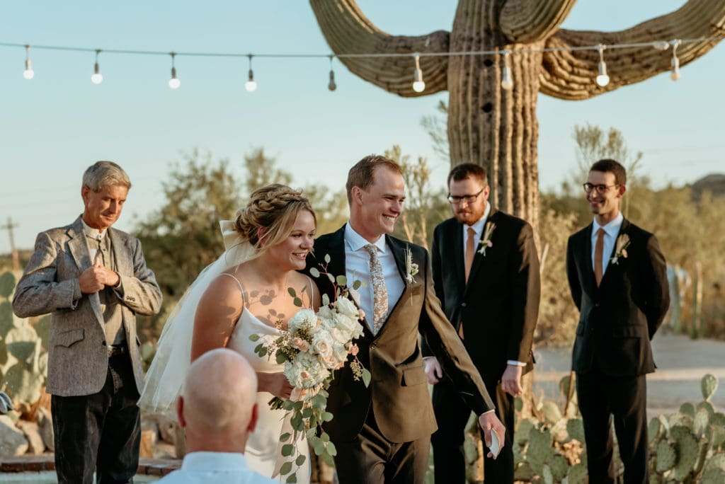 Couple smiling as they walk back up the isle during their Phoenix elopement
