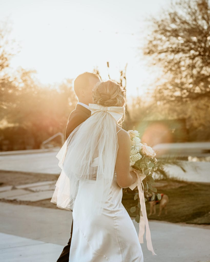 The first walk as husband and wife as the sun envelopes them after their Arizona desert ceremony