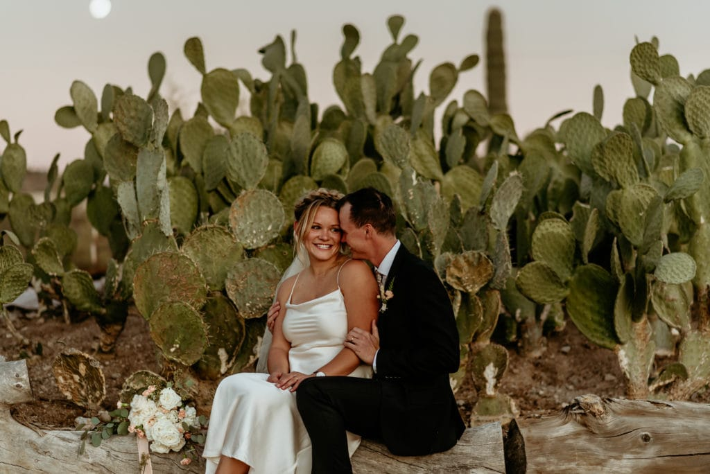 Bride and groom taking a moment to just be and be in the moment surrounded by the beauty of the Arizona desert