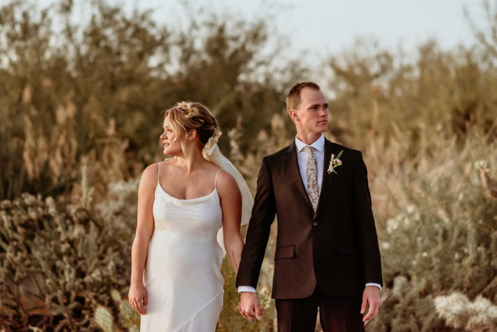 Couple holds hands as the sun sets on their Phoenix elopement