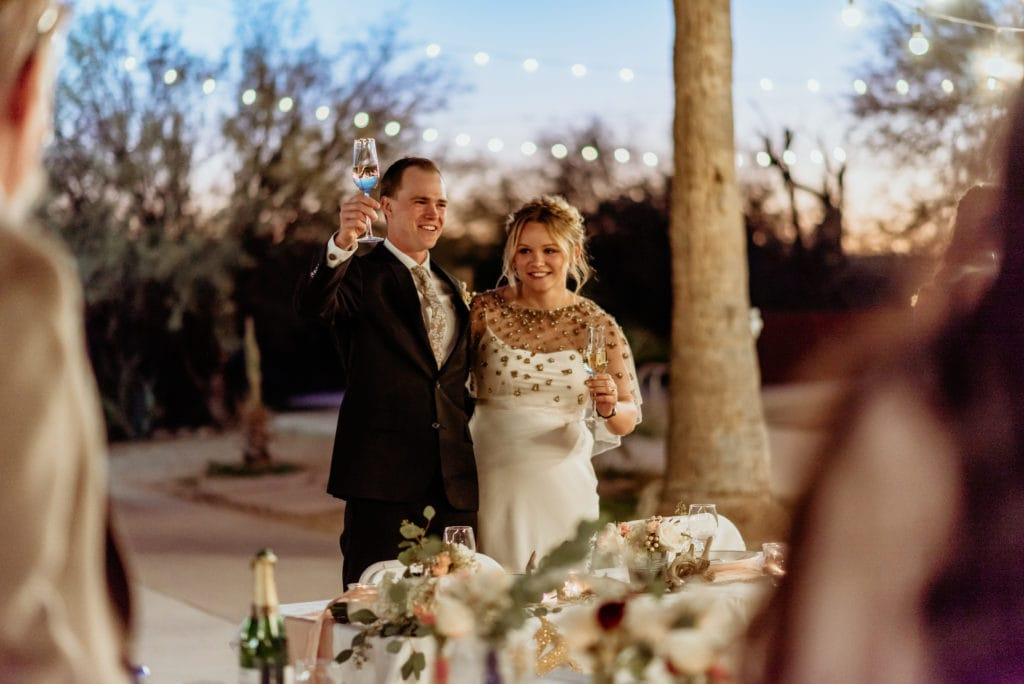 Toasts during their intimate wedding reception