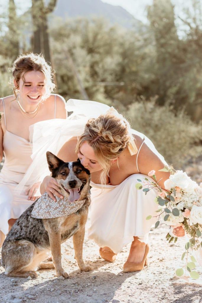 Bride kissing her flower girl cattle dog Kyote