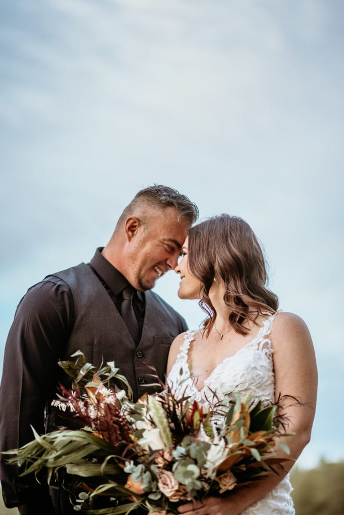 Happily married couple during their northern Arizona wedding