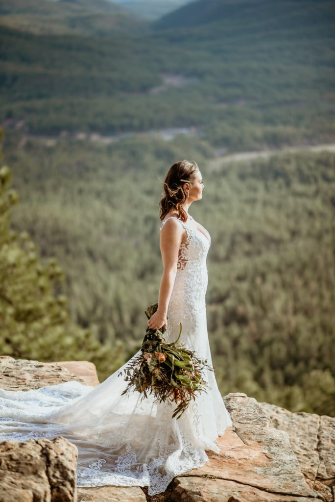 Bride facing into the sun as she stares into the distance during her northern Arizona elopement