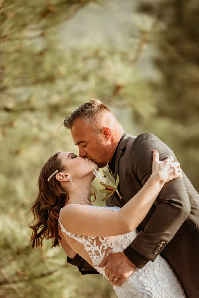 Bride and groom embrace in a romantic kiss during their northern Arizona elopement