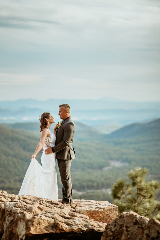 The sky is the limit as sweet bride and groom embrace on the edge of a Mogollon Rim cliff