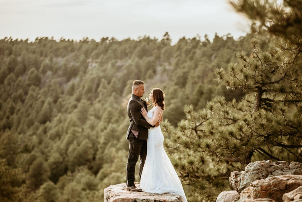 Sun glowing around this newly married couple on the edge of the Mogollon Rim