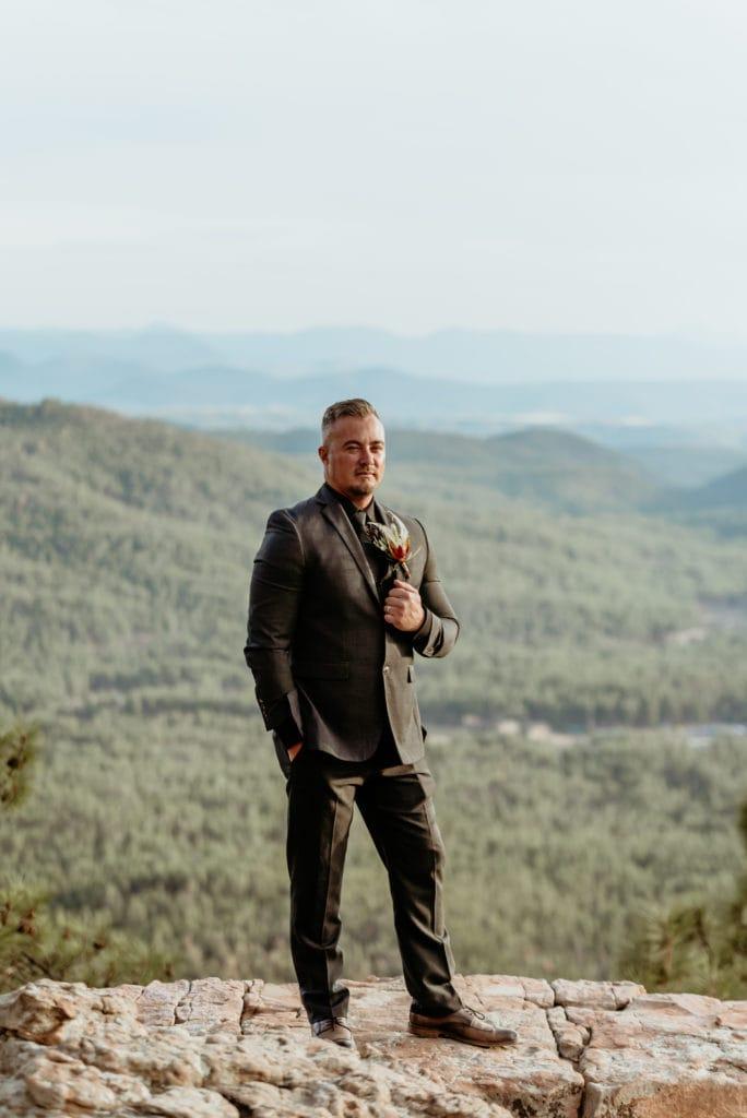 Groom in all black wedding suit