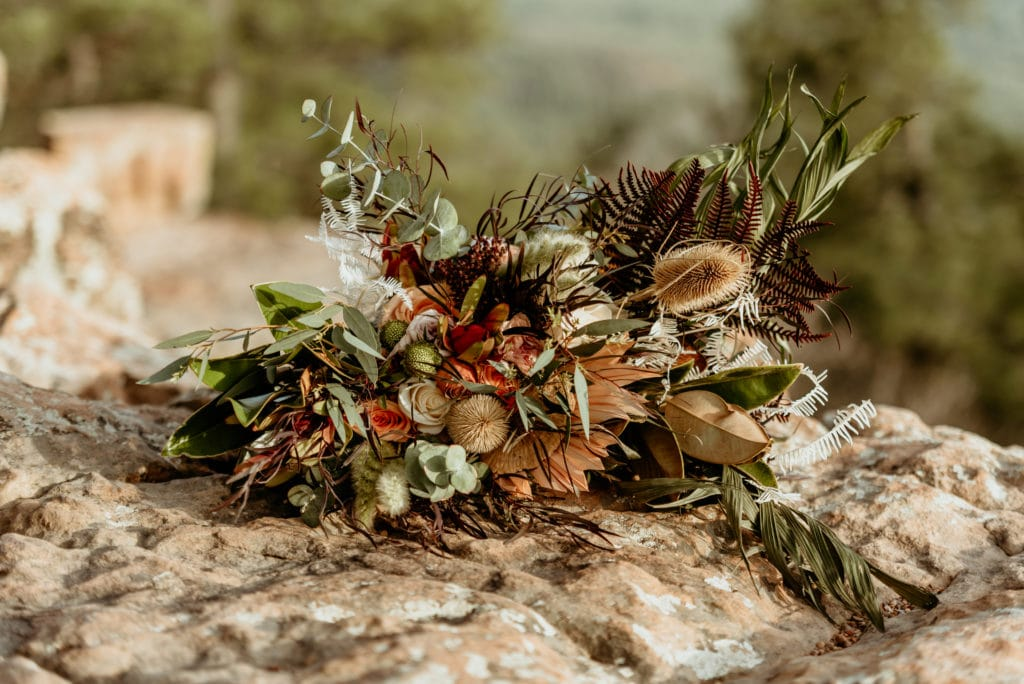 Unique boho wedding bouquet with funky textures and a mix of bold and earthy colors