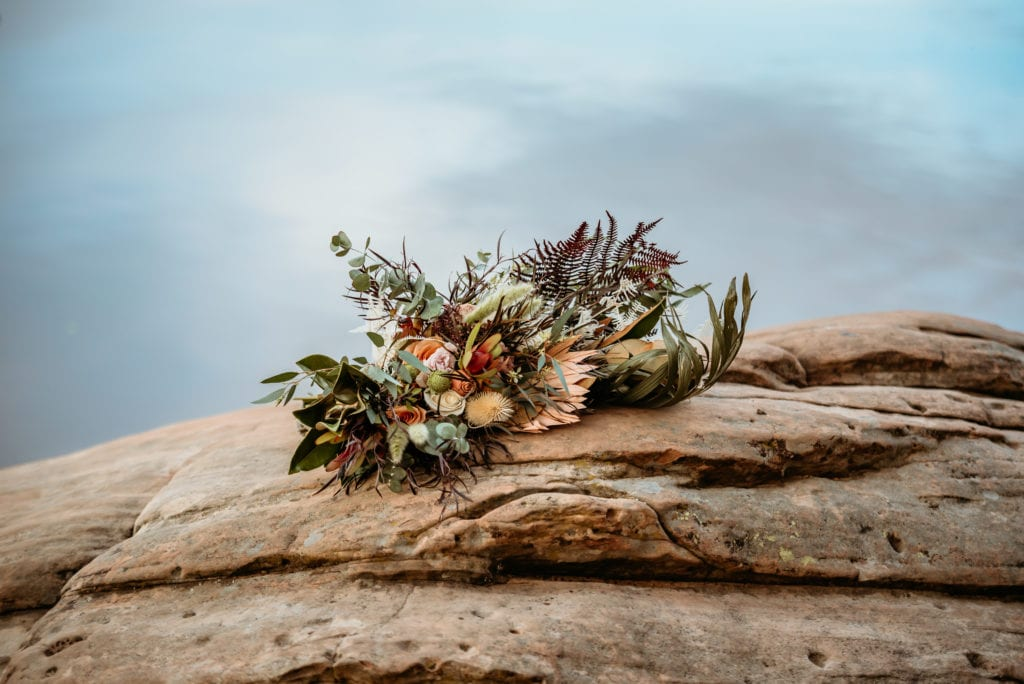 Boho bouquet laid on a rock during a winter elopement in Arizona
