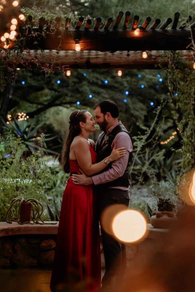 First dance in fire red wedding dress under the magical fairy lights at Tucson Botanical Gardens Wedding