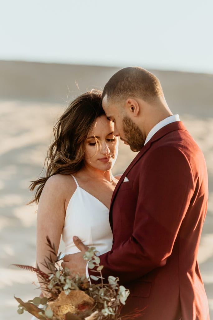 Intimate moments during a sand dune wedding