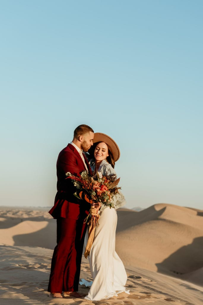 Boho wedding couple laughing during Glamis wedding sunset