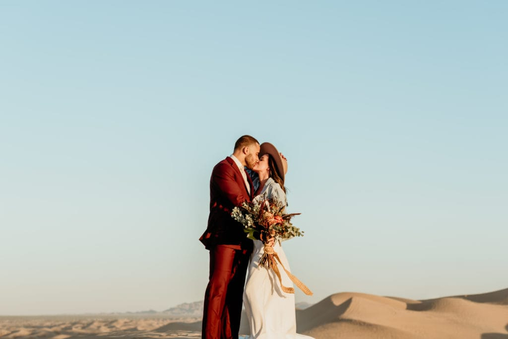 Boho couple in bold colors and minimalistic details during their Imperial Sand Dune wedding