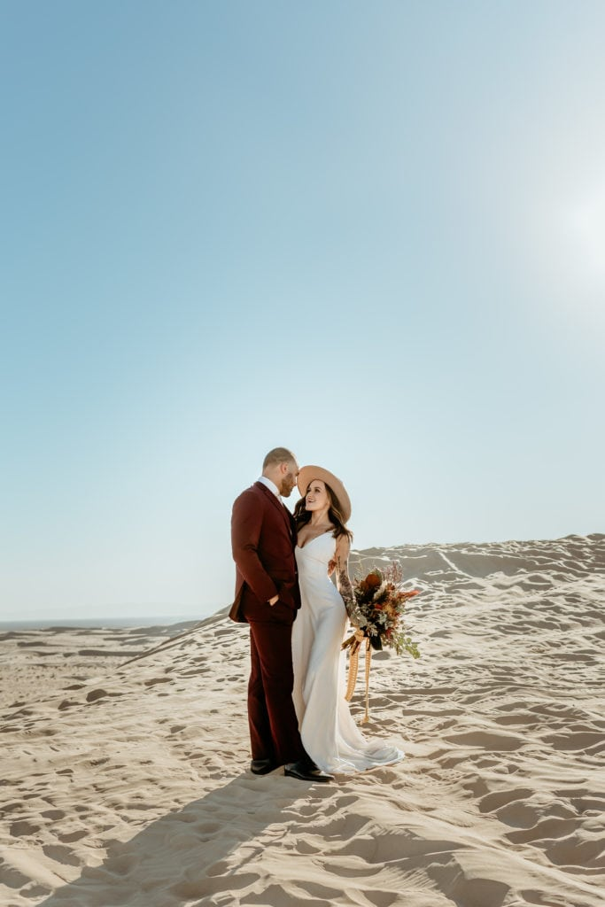 Couple gazing at each other at Glamis Sand Dunes