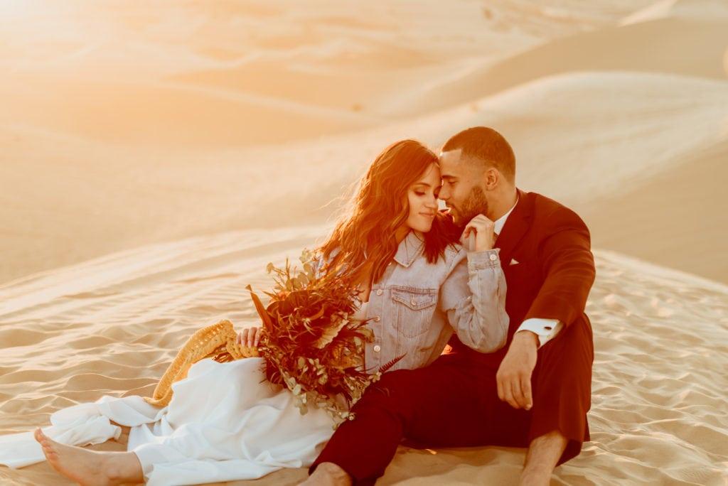 Golden light envelopes couple during their Sand Dune wedding