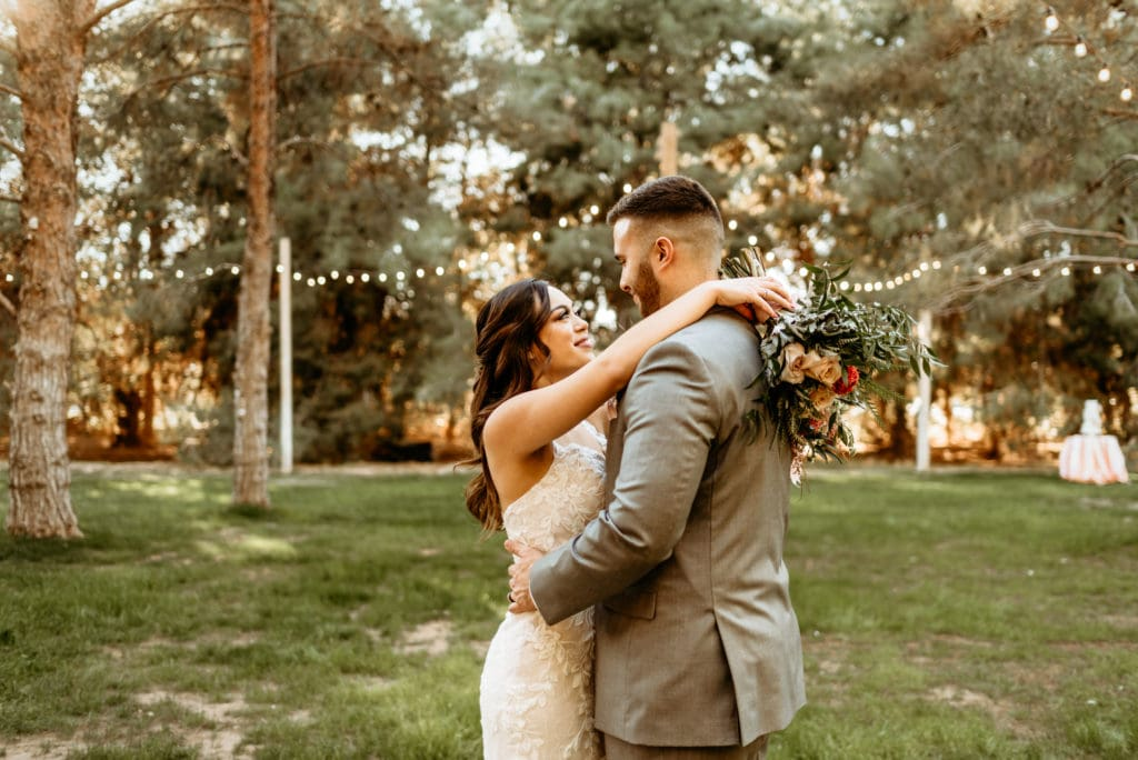 Couple dancing in the meadow at Schnepf Farms during intimate wedding