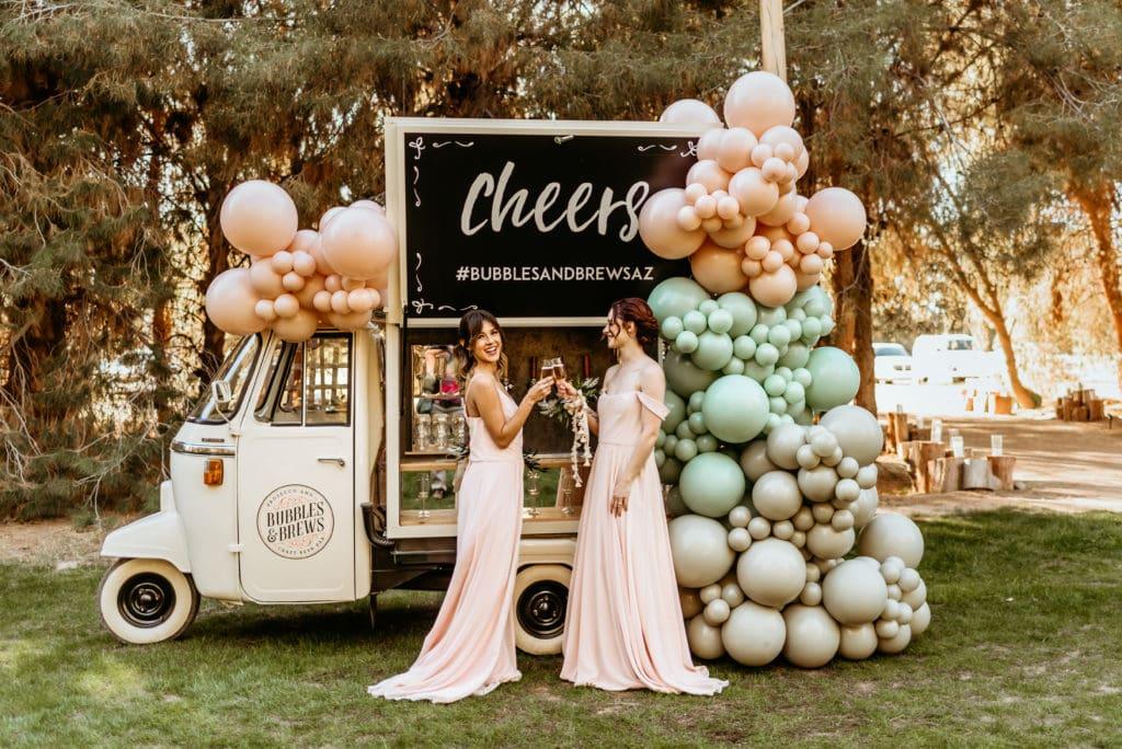 Bridesmaids toasting at the Bubbles and Brews traveling bar