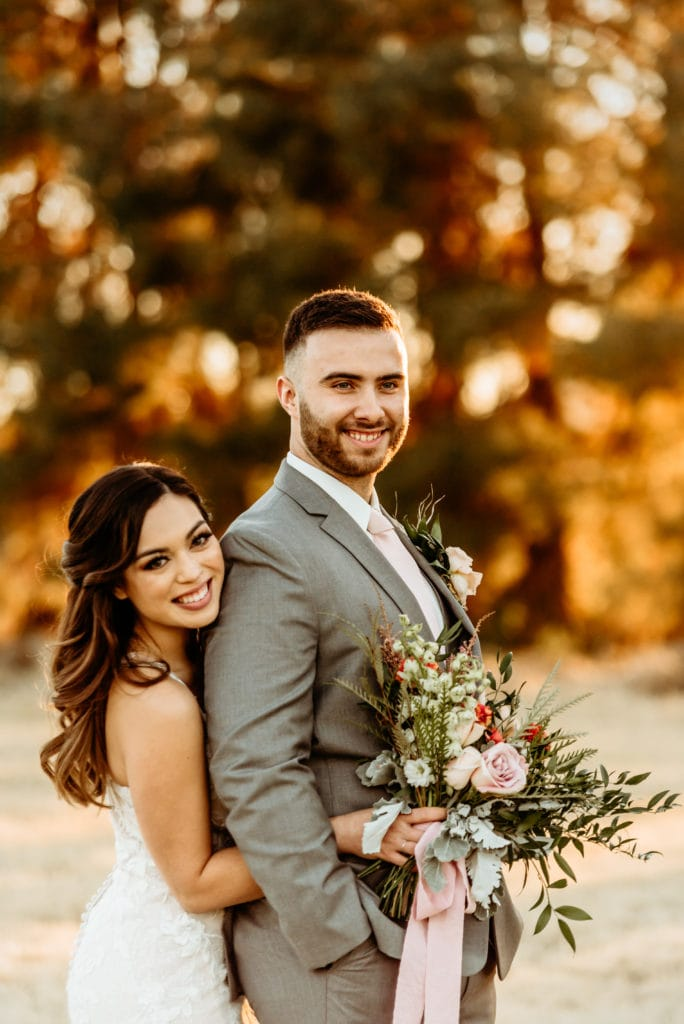 Hugs and smiles at sunset during Schepf Farms wedding
