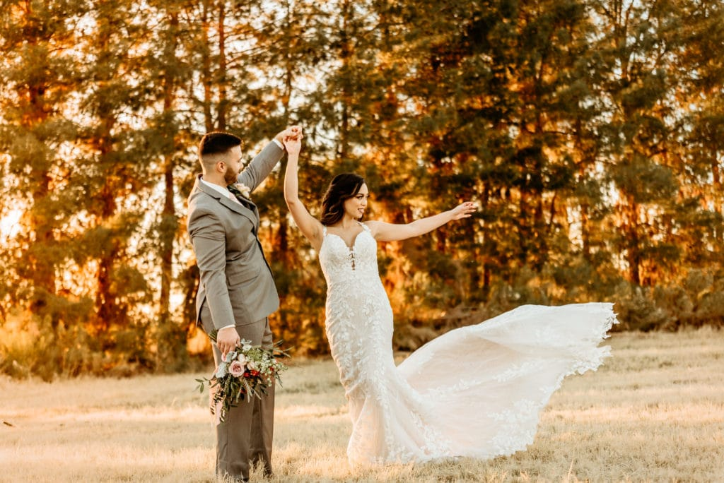 Bride's dress flying as she twirls during Schnepf Farms wedding