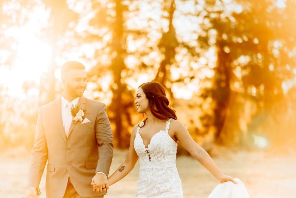 Sunset glow surrounding wedding couple during wedding