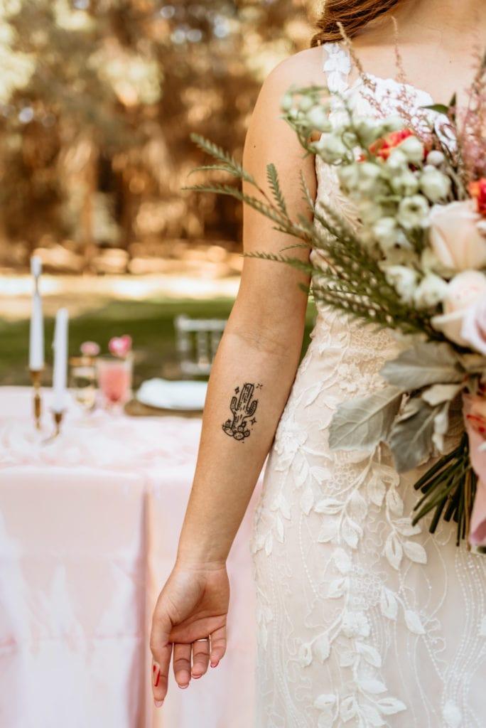 Bride's tattoo of a saguaro