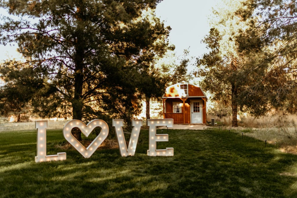 Marquee Love in front of the Schnepf Farm red barn in the meadow