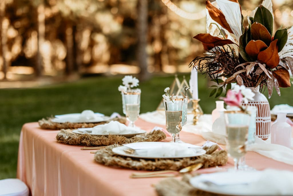 Reception table decorated with florals and rustic charm at Schnepf Farm wedding