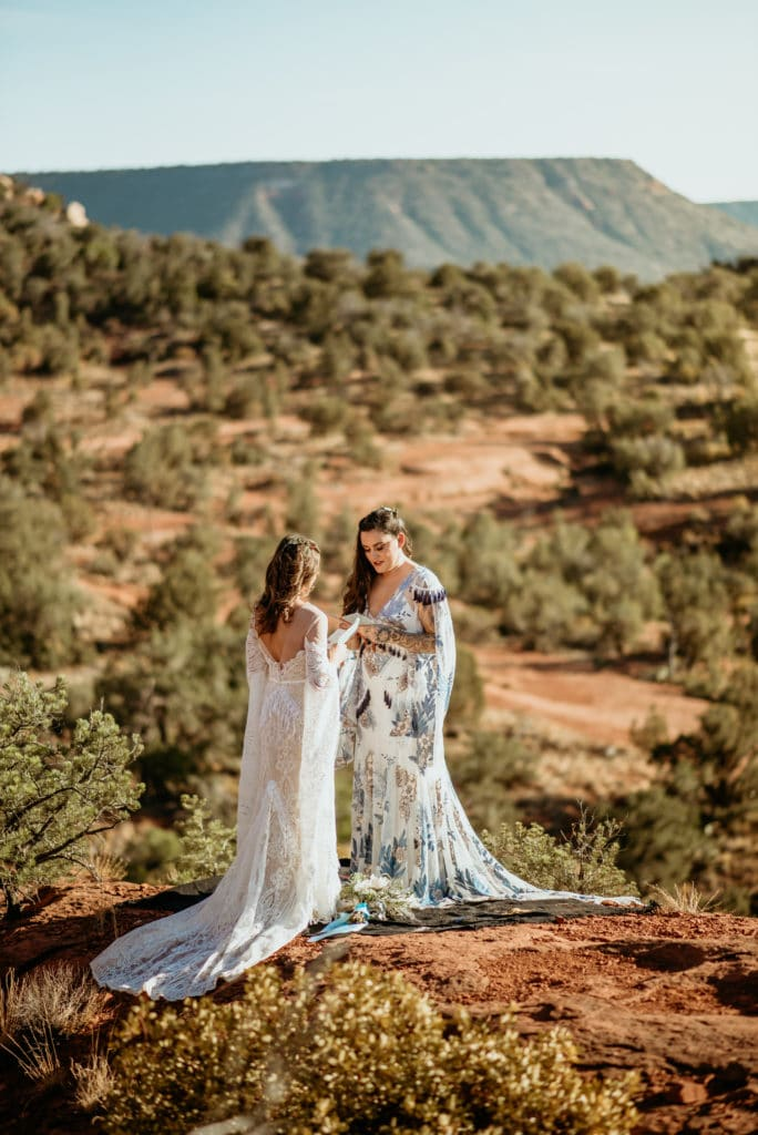 Brides saying their vows to each other during Courthouse vista wedding